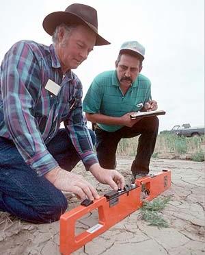 two technicians doing in-field salinity measurement