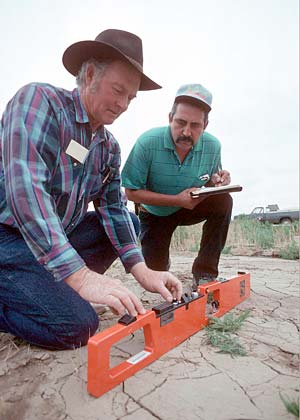 two technicians doing in-field salinity measurement