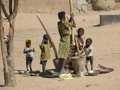 African children pounding grains