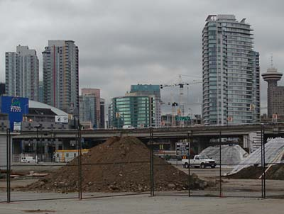 Pile of soil with skyscrapers in background